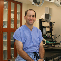 Dr. Mark Deutsch of Perimeter Plastic Surgery smiles at his practice.