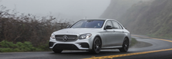 2019 MB E-Class exterior front fascia and drivers side on foggy winding road