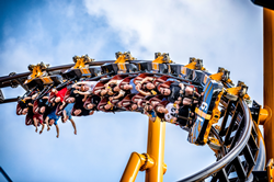 Riders roll through one of The Steel Curtain's North American-record 9 inversions on the ride's media day on July 12, 2019.