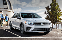 family walking up to 2019 vw passat
