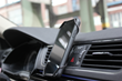 The innovative 'butterfly' smartphone holder attached to the vents of a car