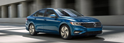 Front passenger angle of a blue 2019 Volkswagen Jetta driving