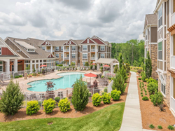 Drucker and Falk Expands in Charlotte, North Carolina with MLA Properties Pavilion Village Exterior and Pool