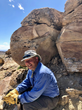 Professor Phil Manning is uncovering amazing fossils at The Jurassic Mile. In fact one is embedded in the rock above his head in this photo.
