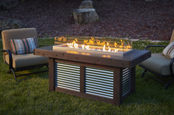 Rustic, corrugated Denali Brew Gas Fire Pit Table with burner cover storage clips and bottle opener by The Outdoor GreatRoom Company for your patio or backyard space