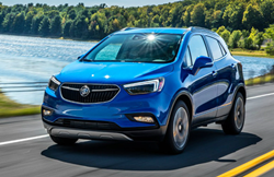2019 Buick Encore driving on road by a lake