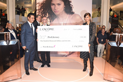 Lancôme Ambassador Zendaya and Lancôme US President Suriya Parksuwan present philanthropy check to ProLiteracy at the Idôle Fragrance launch at Macy's Herald Square in New York City.