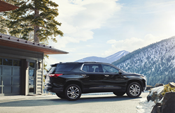 black Chevrolet traverse on a mountain