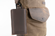 "Executive Leather iPhone Sleeve — full-grain ""chocolate"" leather attached to bag with optional carabiner"