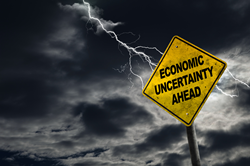 street sign that says economic uncertainty ahead