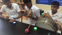 An earlier iteration of Muss-Bits, being tried out by deaf students in Sri Lanka.