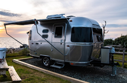 Exterior view of a silver 2020 Airstream Caravel travel trailer