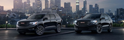 Two GMC Terrain crossover SUVs parked next to each other