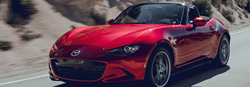 2019 Mazda MX-5 Miata driving down a rural highway