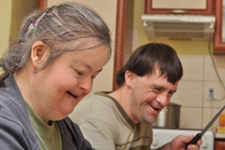 Two older adults with Down syndrome cooking