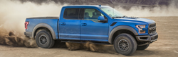 side view of a blue 2020 Ford F-150 Raptor