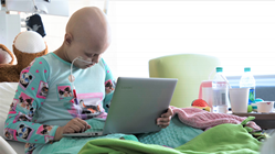 Pediatric cancer patient with Mikey's Way gift of a brand new laptop computer