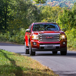 2020 GMC Canyon driving on a sunny summer day