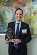 "Rob Boroff poses with the ""Emerging Leader Award"" presented from TIDA."