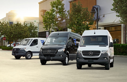 three Mercedes-Benz vans in a row