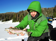 Ice fishing is another activity for guests to enjoy at Brooks Lake Lodge, nestled in the Shoshone National Forest near Jackson Hole, Wyoming, and Yellowstone National Park.