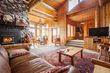 The cabin suite at Brooks Lake Lodge near Dubois, Wyoming, includes a comfy sitting area, fireplace, sofa-bed and private bedroom with king-sized lodgepole pine bed.