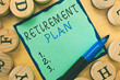 The words retirement plan on a sticky note