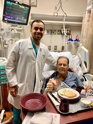 Patient and doctor pose together after surgery.