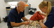Dr. Joel Parrott, CEO and President at Oakland Zoo, performing a routine checkup for Summer, the Fennec fox