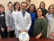 Naveed Khan, M.D. of Shady Grove Fertility celebrates with staff.