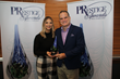 PRmediaNow Principal Colin Trethewey (right) receives a PRSA Tampa Bay PRestige Award for media relations tactics in recognition of the firm's work on the successful PEEjamas campaign.