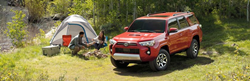 A 2020 Toyota 4Runner SUV parked at a campsite