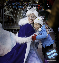 Princess and kids and their families enjoy WinterfestOC festivities in Costa Mesa.