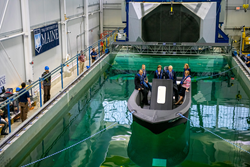 3D Printed boat 3Dirigo in pool with Maine congressmen aboard