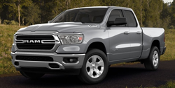 2019 RAM 1500 Big Horn 4x4 Crew Cab truck parked on the grass.