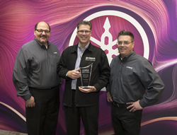 From left: Travis Mitchell, director, piano channel sales, Yamaha Corporation of America (YCA); Rich Galassini, owner, Cunningham Piano Company; Robert Nolen, district manager, YCA.