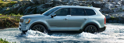 2020 Kia Telluride profile driving through the river