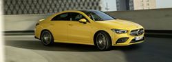 2020 MB CLA Coupe exterior front fascia and passenger side on blurred parking garage lane