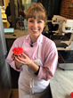 Sarah Wallace, Magnolia Bakery's General Manager and competitor on Food Network's Holiday Baking Championship, with a finished Valentine's cupcake