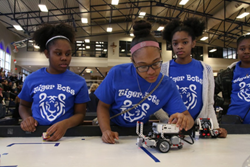 Marian Girls hard at work at the Clavius Project Robotics Jamboree, a prior project funded the MDEF