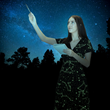 Reach for the stars in this elegant, glowing celestial Katherine dress from Svaha. This dress is an homage to Cartographer of the Universe, Margaret Geller. Available at www.svahausa.com.