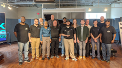 Fox Music House operations manager Joseph Fox, center, holds the dealership's Yamaha 2019 Dealer of the Year award for the Southeastern region, surrounded by Fox Music House's team.