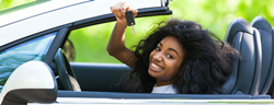 Woman in convertible holding up car keys