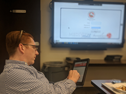 Terrence McGregor, Coordinator for the Health Programs COVID-19 Operations Center at Los Angeles County Fire, navigates the MEDIVIEW TRIPS software program
