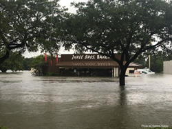 View of Three Brothers Bakery surrounded by water during Hurricane Harvey