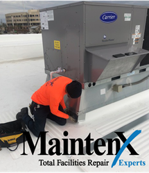 A MaintenX team member does repair on a roof.