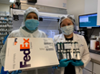 Nevine Khedr, CPhT Supervisor (left), and Pharmacist Ann Shin (right) mailing hand sanitizers to Hoboken Police Force to stay safe while on-duty during COVID-19 pandemic.