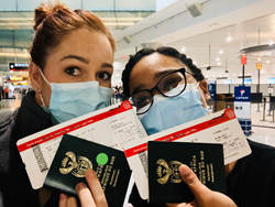 South African Travelers holding passport and boarding passes