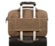 Three carry options: handles, a shoulder strap, and a wheeled suitcase passthrough