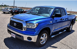 A front and side view of a 2007 Toyota Tundra parked at the Matador Motors vehicle lot.